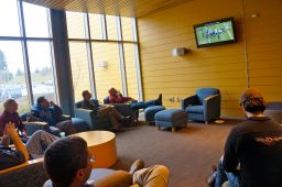 In the STAR Center lounge conference participants take a break from sessions to watch the Seahawks play-off game.