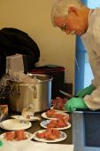 Mark Nelson of WSU prepares beef for the Grain vs. Grass Fed Meat Quality session.